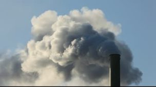 stock-footage-factory-smokestack-blowing-fume-into-the-atmosphere